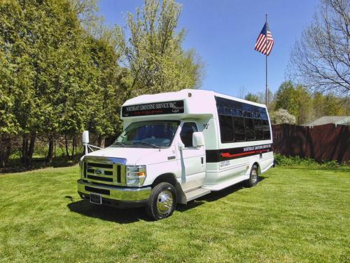 17-passenger-executive-limousine-bus-outside